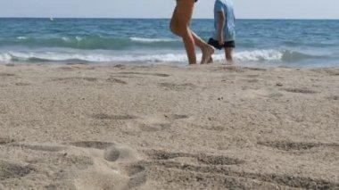 Children stroll along shores of the Mediterranean Sea