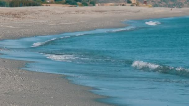 Beautiful turquoise waves of Mediterranean Sea that wash the sandy shore