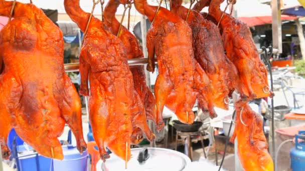 Street food in Thailand and Asia. Red Peking duck on counter. Exotic dishes on the streets