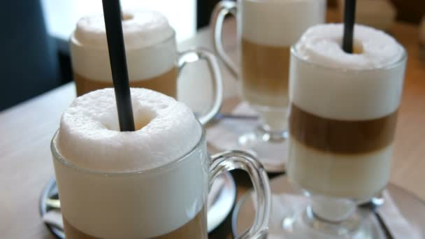 Beautiful glasses with coffee latte and big foam in the cafe on the table