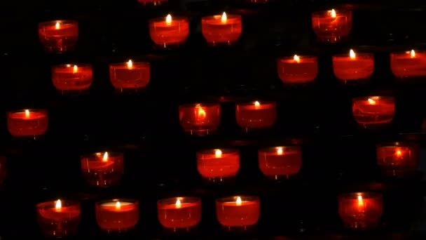 Burning red round candles in catholic church
