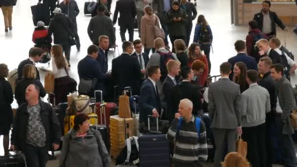 Munich, Germany - October 25, 2019: Central railway station. A group of people in business suits and suitcases greet each other