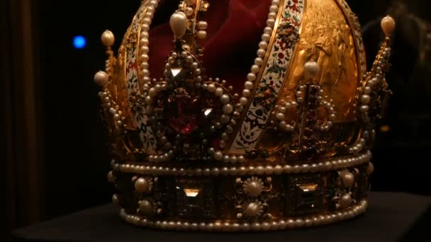 Real old vintage antique royal crown for official coronations, decorated with gold, diamonds, rubies, sapphires and other precious materials.