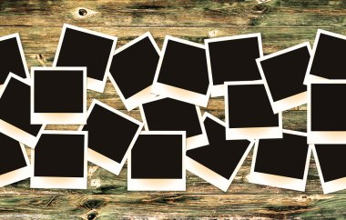 Photo frames pack on old painted vintage wooden background retro filtered
