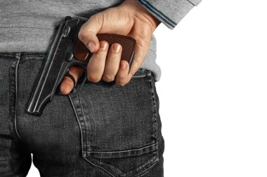 A man holding a gun in his hand behind his back, close-up view. Concepts: crime, attempted murder, a gunshot wound, the killer. Isolated background. stock vector