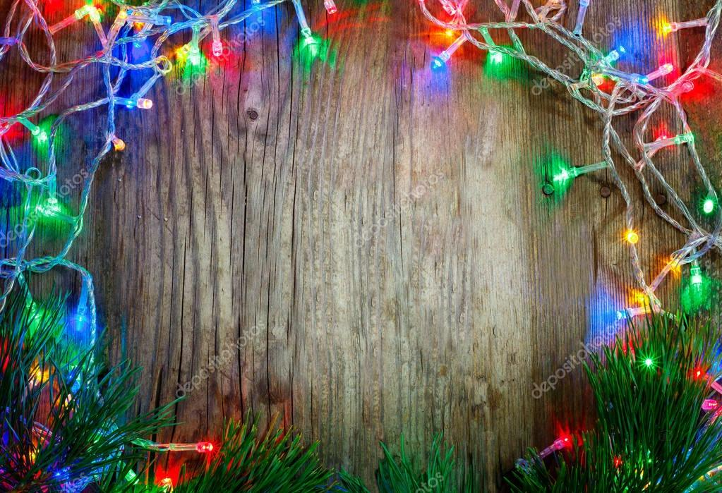 colorful christmas garland lights on wooden rustic background christmas decorations holiday mood beautiful new year composition photo by igorbukhlin
