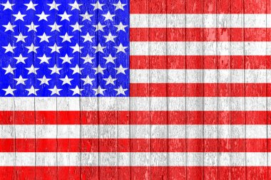 The USA flag painted on a wooden fence. Political concept. Old texture. Vintage design. Closeup view. The symbol Of America.