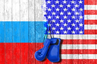 Flag of Russia and USA painted on the wooden board. Arms race and rivalry. The third world war. The conflict between Russia and America. Political concept. Front view.