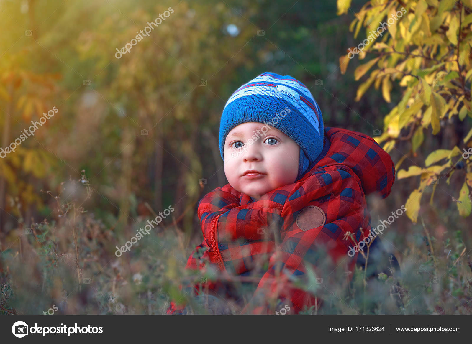little cute baby siting in the grass. lifestyle, fashion and trendy