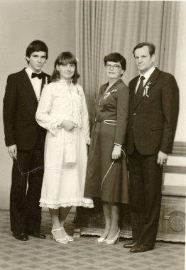 Vintage photo shows a bride, bridegroom and parents. Retro black & white  photography.