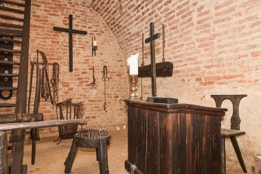 Inquisition torture chamber. Old medieval torture chamber with many pain tools.