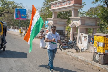 AMRAVATI, MAHARASHTRA, INDIA, JANUARY - 26, 2018: Unidentified people and student celebrating the Indian Republic Day by dancing with flags, drums.