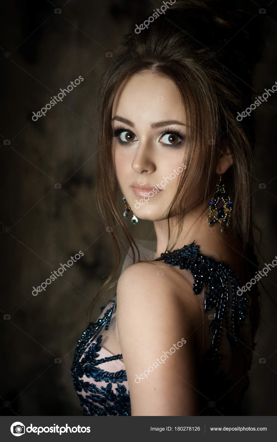 Beautiful Young Brunette Girl In Evening Image With Makeup And