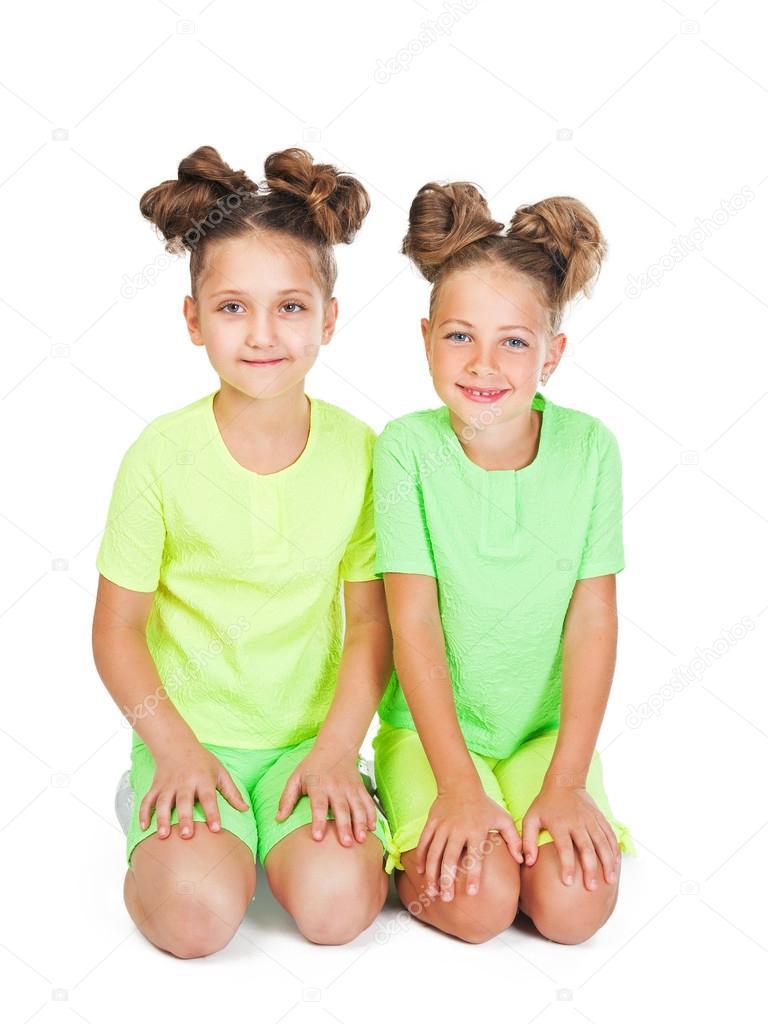 Two little girls in similar fancy garb — Stock Photo © inna