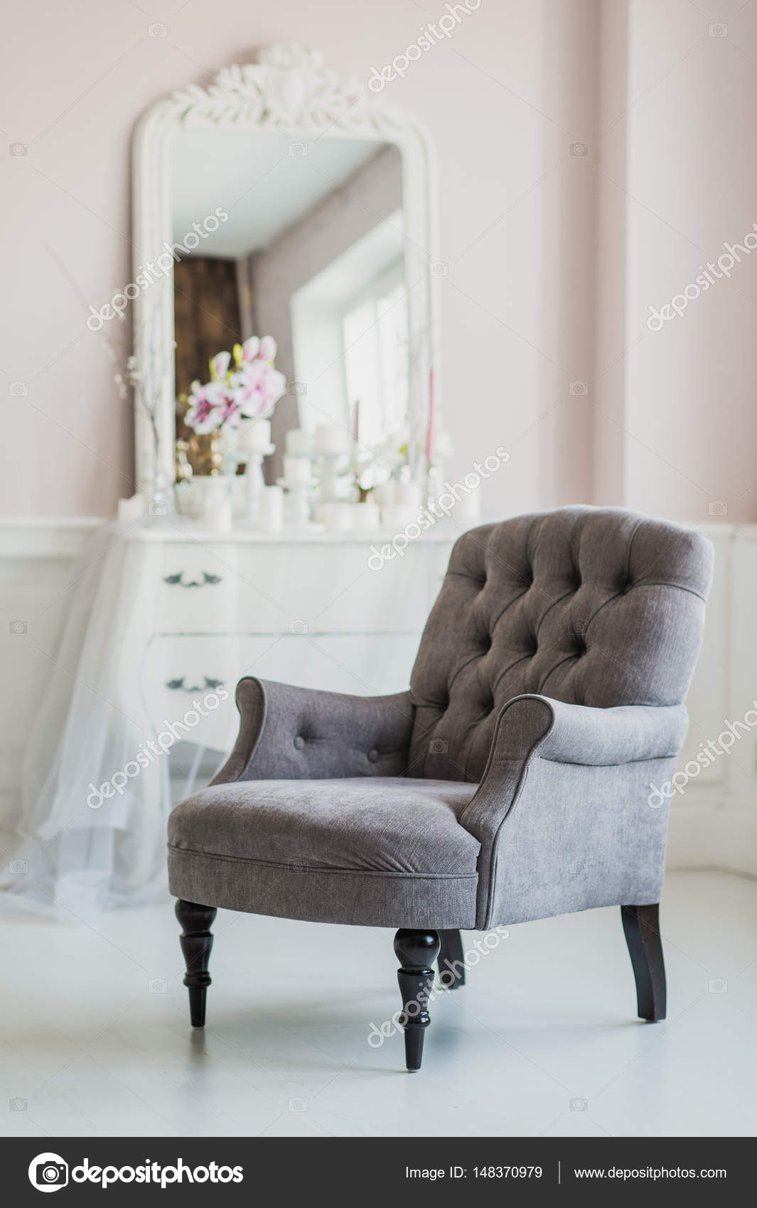 beige color upholstered chair in living room with flowers — Stock ...