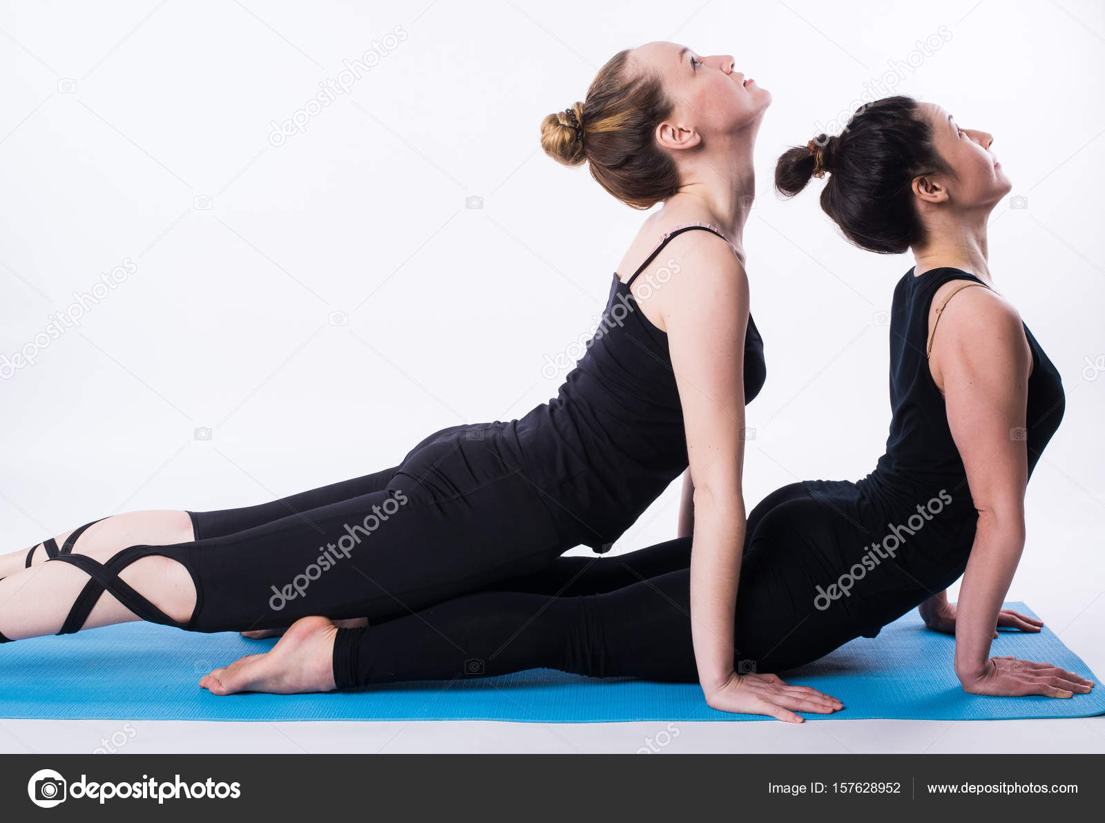 Double Person Yoga Poses Fitness Practice Group Of Two Beautiful Fit Young People Working Out In Sports Club Doing Stretching Exercises Together In Class Double Downward Facing Dog Yoga Pose Adho