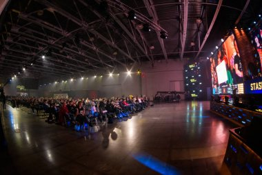 MOSCOW - DECEMBER 23 2019: esports Counter-Strike: Global Offensive event. Main stage venue, big screens and lights during tournament game. Big crowd at arena.