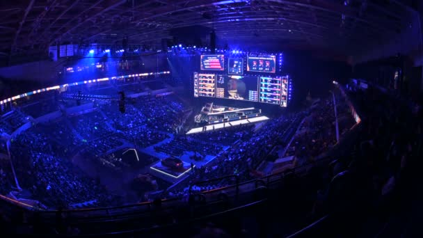MOSCOW, RUSSIA - 14th SEPTEMBER 2019: esports Counter-Strike: Global Offensive event. Main stage with a big screen showing the matchs game moments. Arena lit with a blue color.