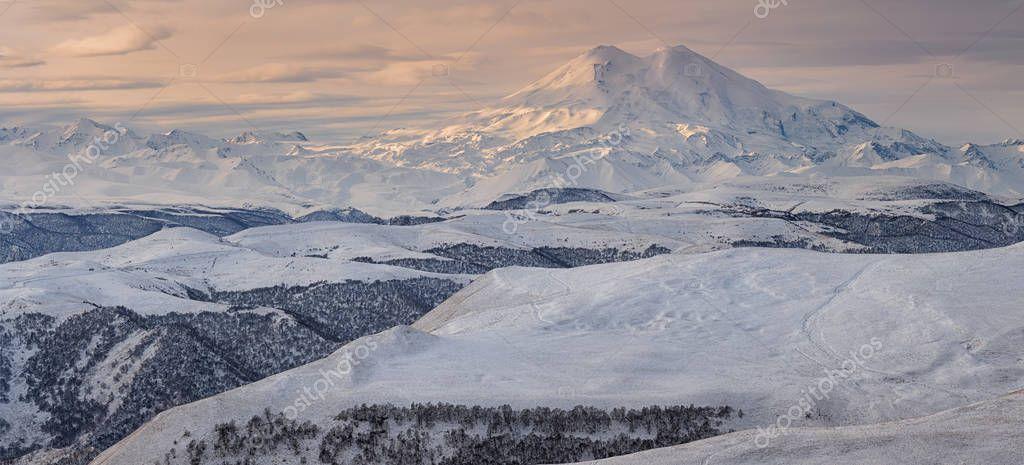 the Caucasus Mountains, Kabardino-Balkaria. Mount Elbrus in the winter sun at sunset.
