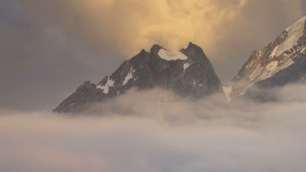 Winter views of the snowy mountains of the Caucasus. Formation and movement of clouds over mountain peaks.