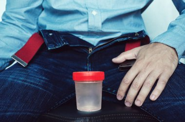 empty plastic container for testing semen or urine