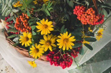 Autumn bouquet with garden flowers and branches of mountain ash.