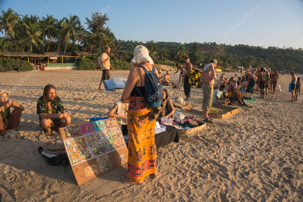 local hippies sell hand-made goods at a flea market in Arambol