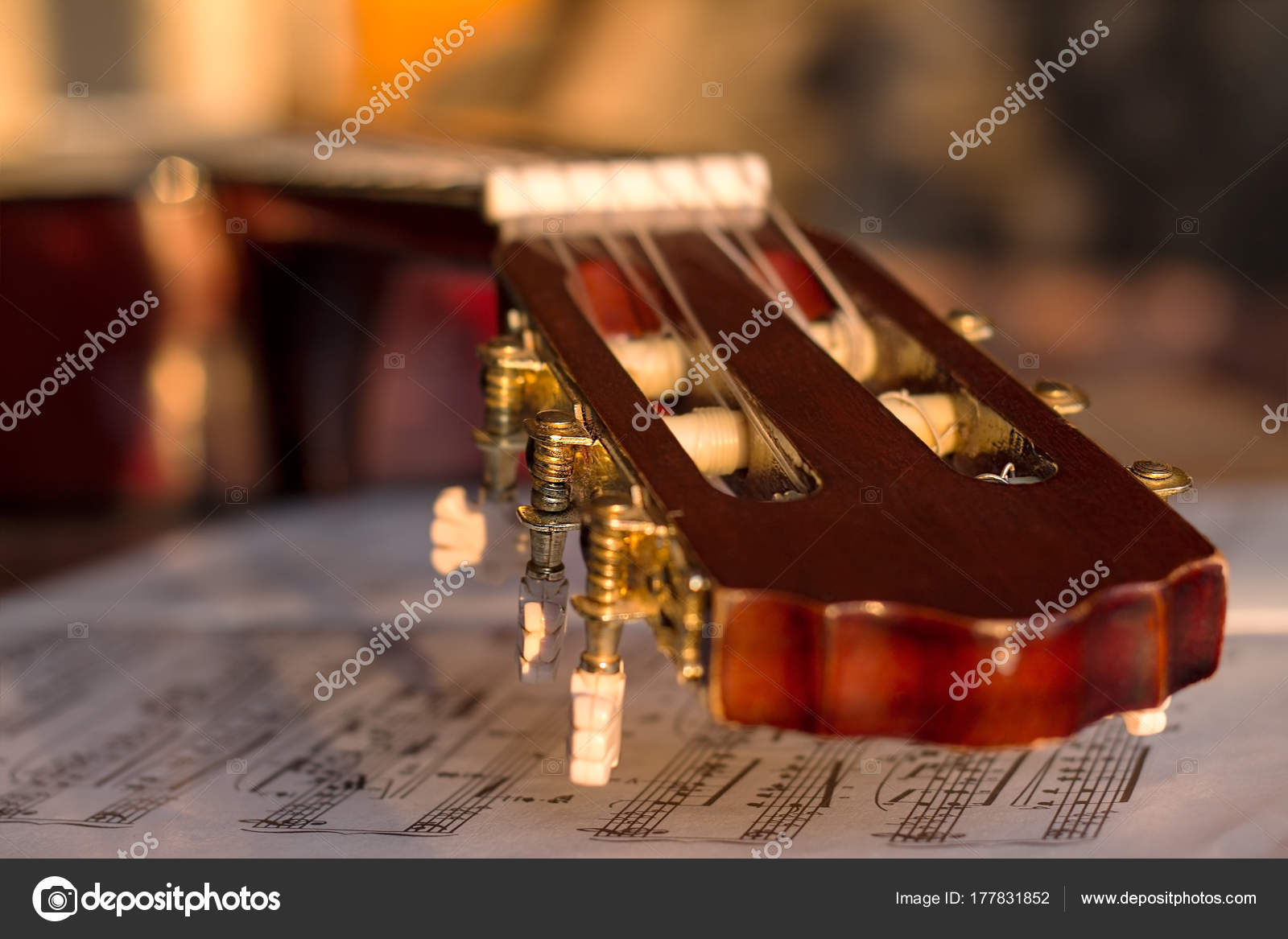 Guitar headstock on old music notes — Stock Photo © n_zim