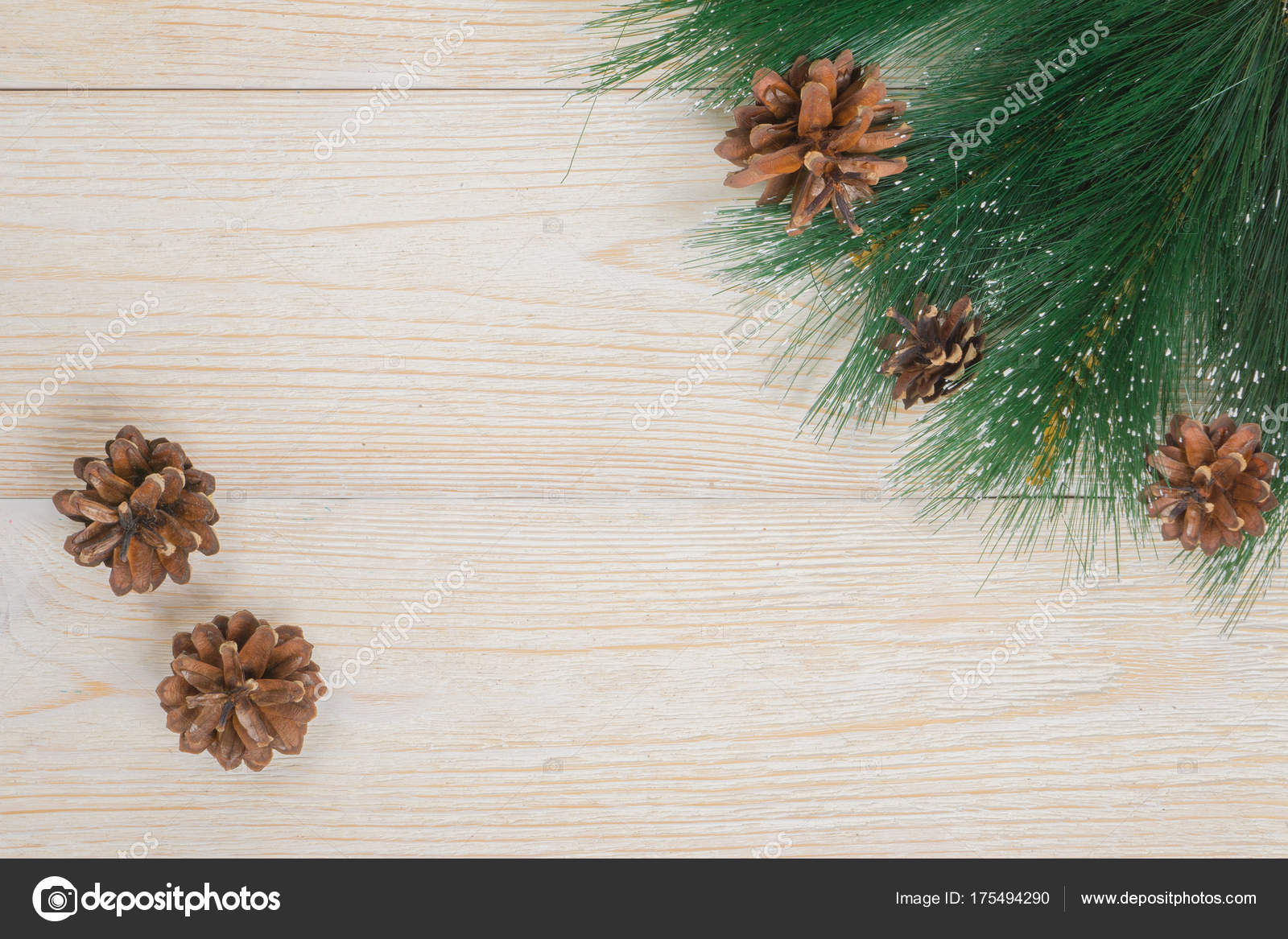 new year background pine branch and cones on rustic table stock photo