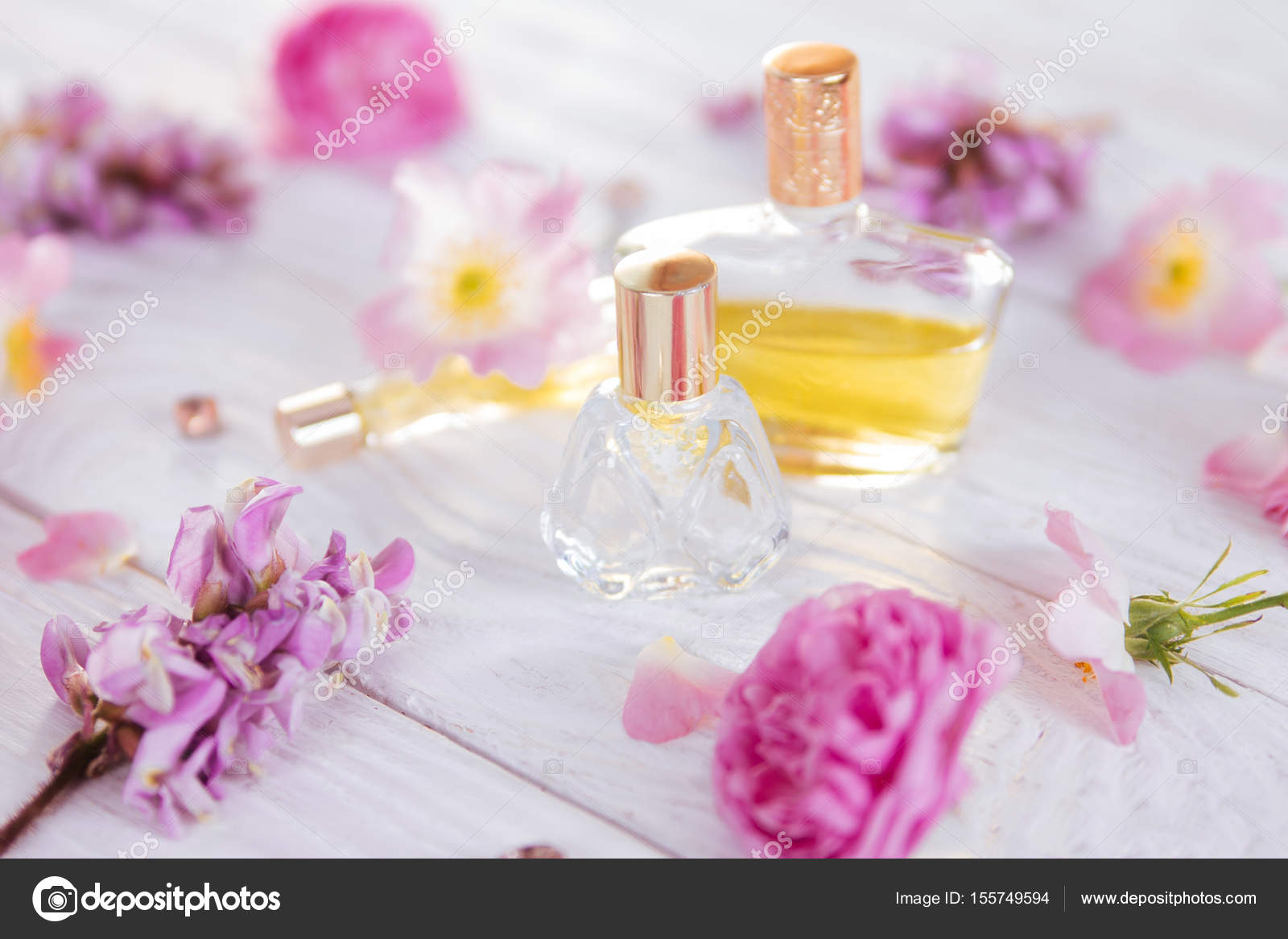 Bottles Of Perfume With Flowers Stock Photo Maryviolet 155749594