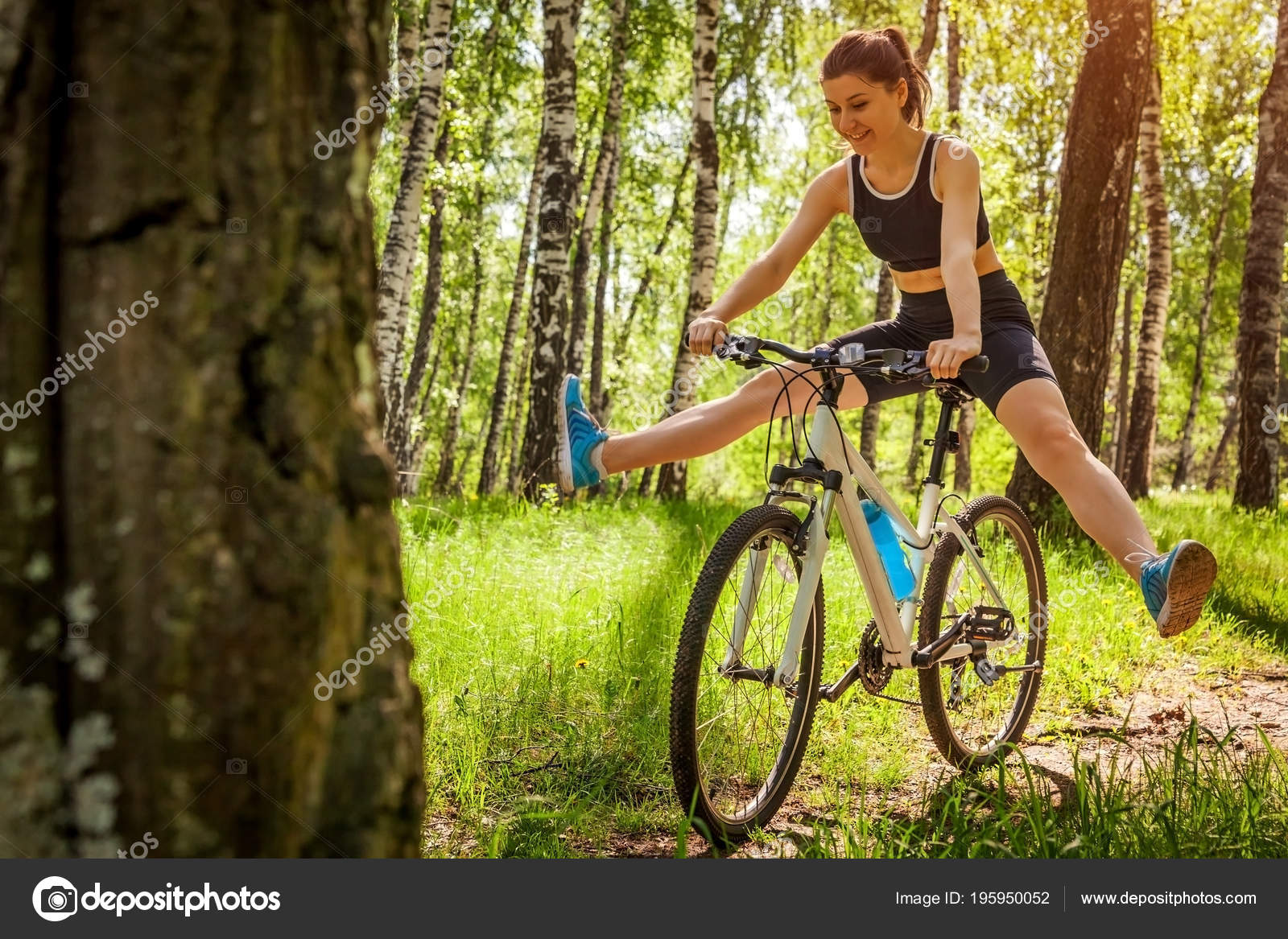 Happy Young Woman Cyclist Riding Mountain Bicycle Spring