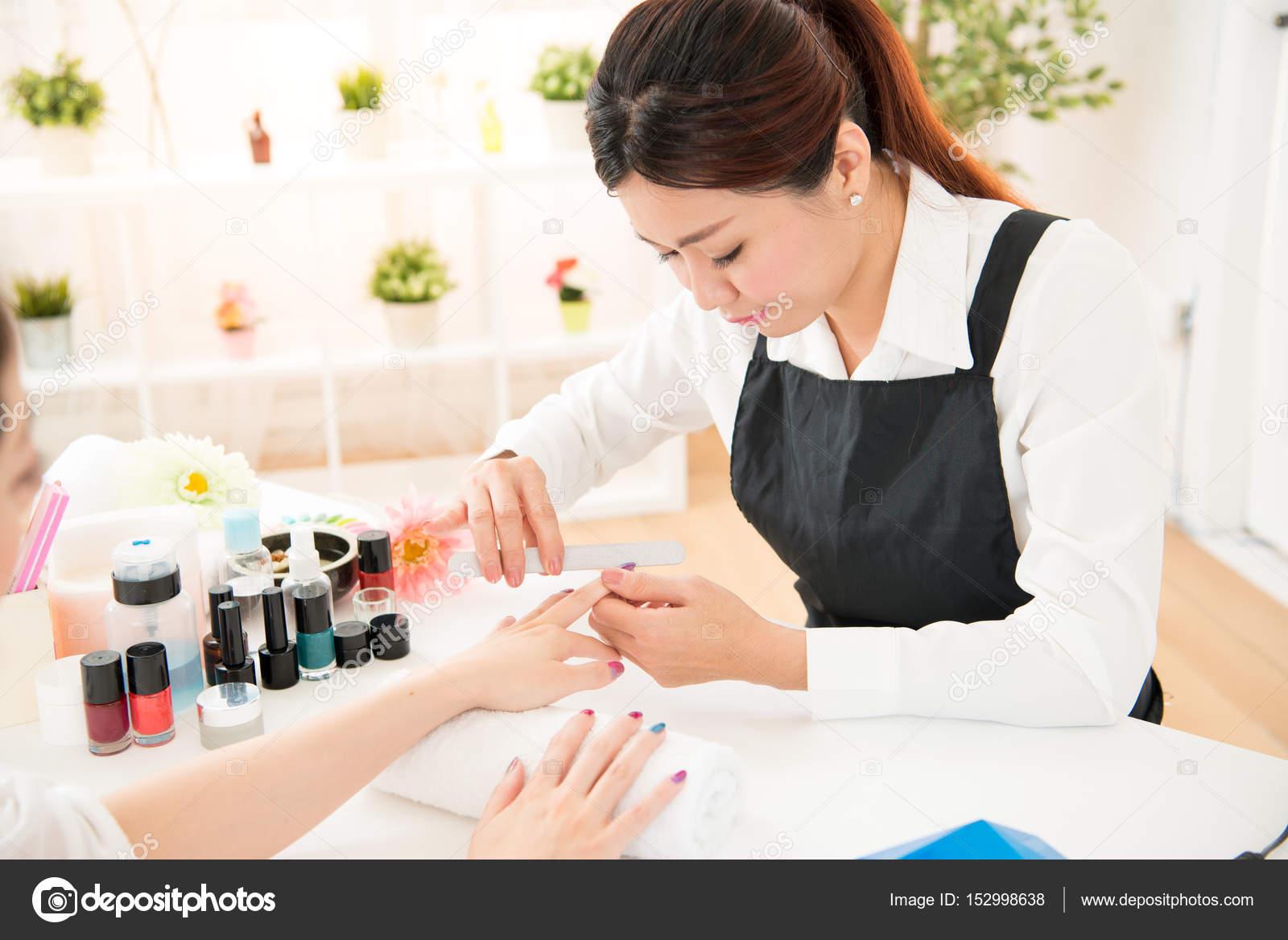 nail filing selective focus of nail salon — Stock Photo ...