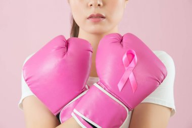 Chinese girl wear boxing gloves crossed arms
