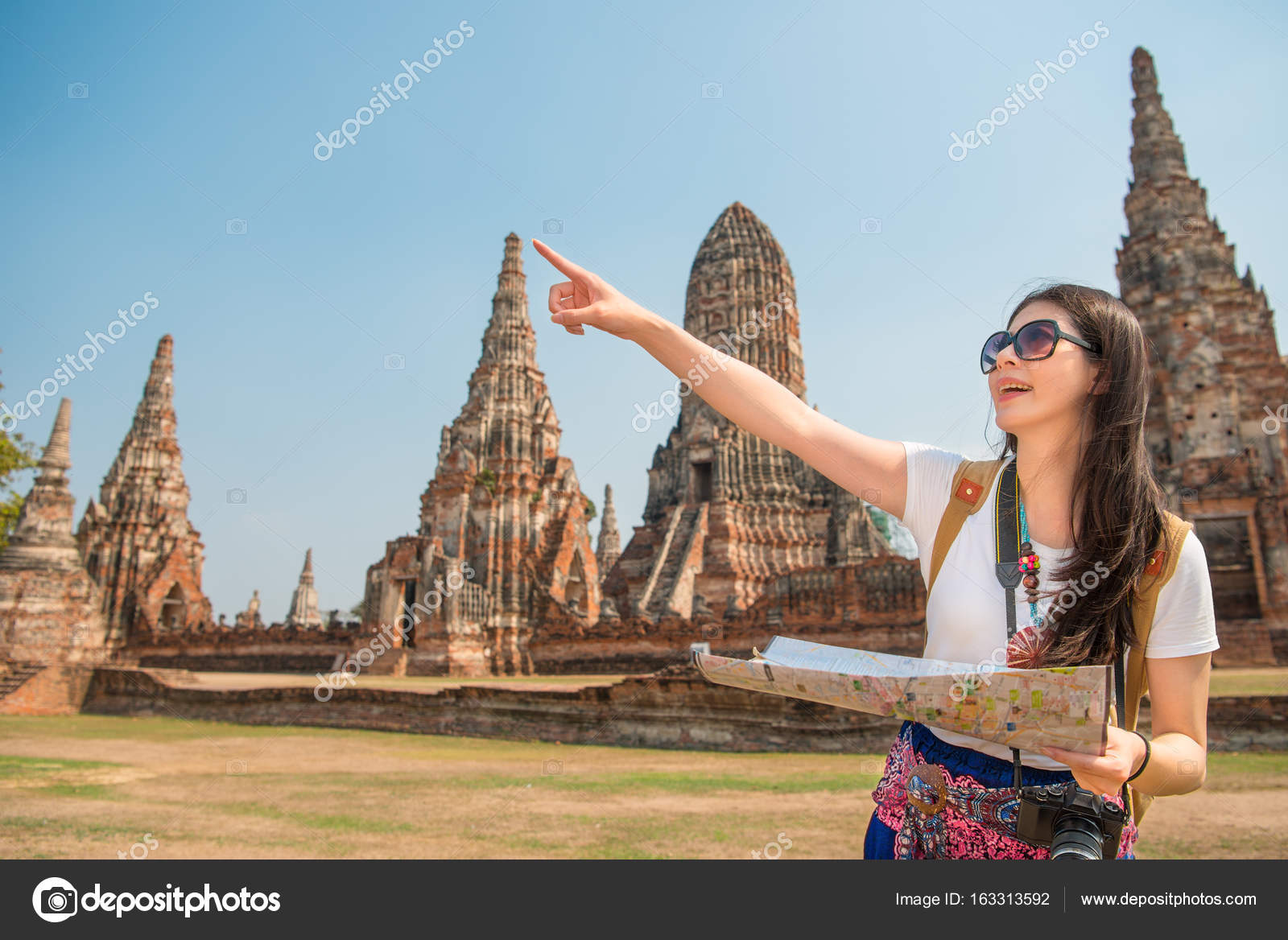 Travel tourist woman holding map stock photo primagefactory travel tourist woman holding map stock photo gumiabroncs Images