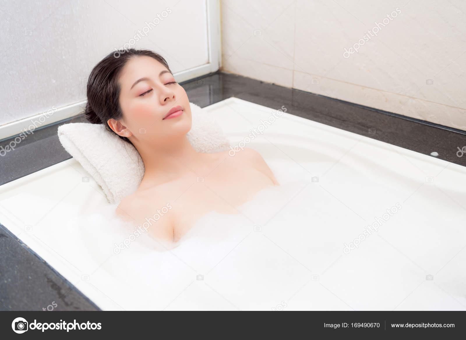 Sweet Pretty Woman Lying Down In Bathtub Sleeping Stock Photo