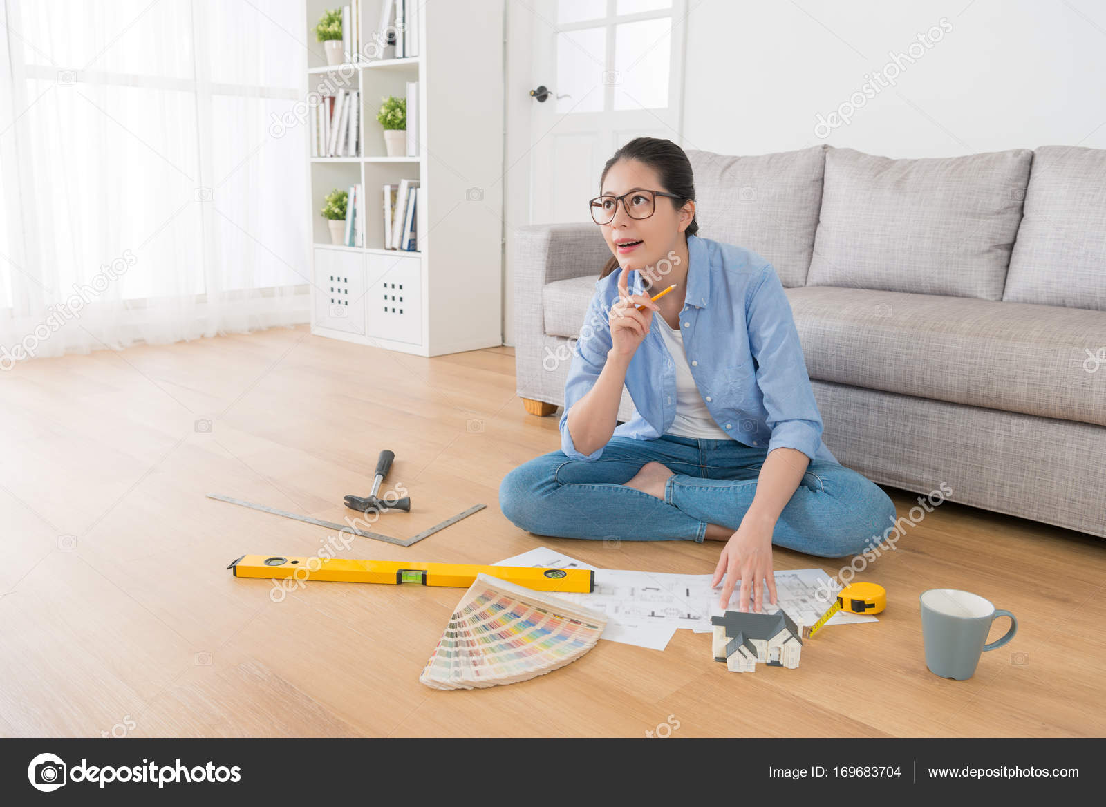 Beautiful Sweet Female Interior Design Engineer Thinking Drawing  Inspiration Idea And Sitting In Living Room Wooden Floor With Sketch Tool.