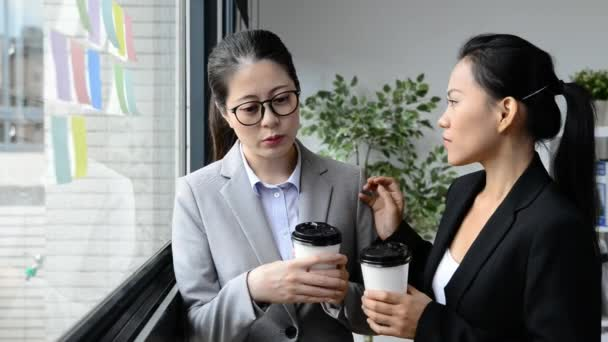 Asian businesswomen manager tries to help her team and ask for having coffee to relieve the depression pressure.