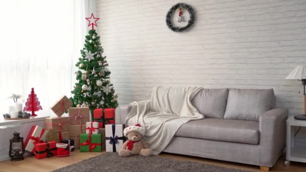 perfect Christmas tree with gifts underneath in bright living room for background