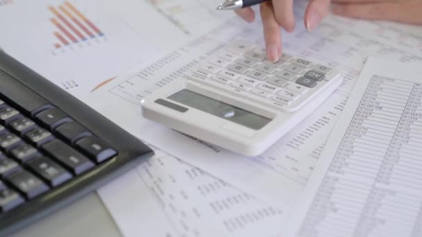 woman using calculator with doing monthly finance at office.