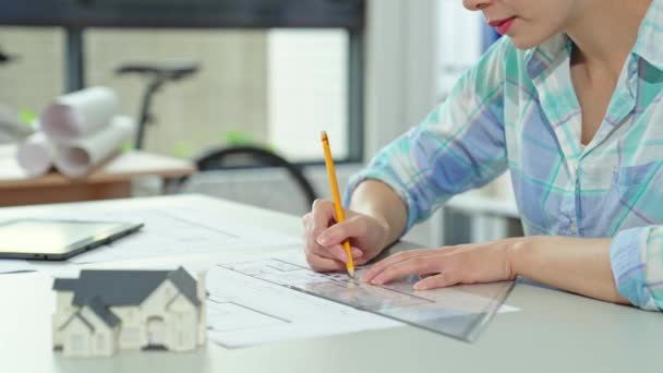 Engineer of architect starting draws a house blueprint on the desk with 3d  print house model in the office