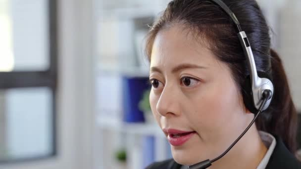 close up portrait of confident female customer service representative with headset in call center