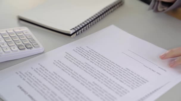 slow motion of Asian Business woman signing a contract document making a deal, selective focus.