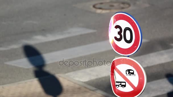 Speed Restriction Road Sign And Pedestrian Crossing The Street