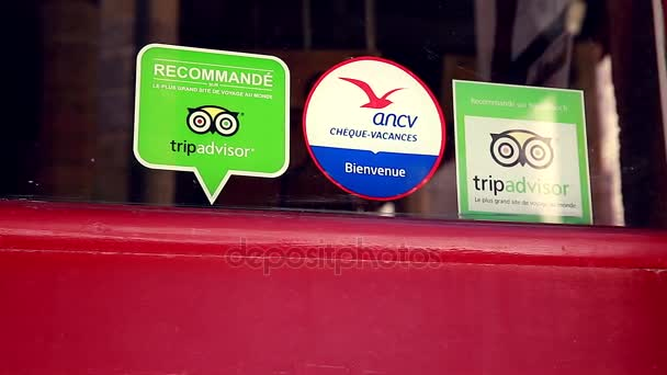 Tripadvisor stickers on restaurant window in france stock video