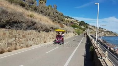 Two Teen Girls on a Quadracycle