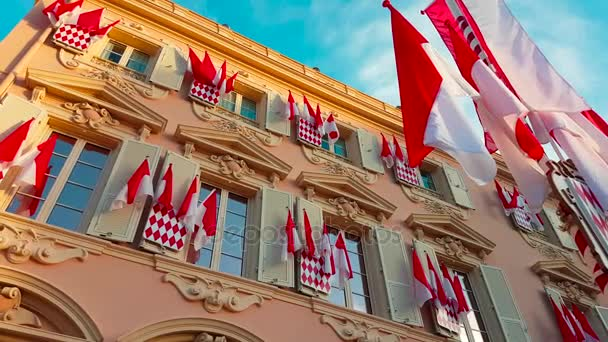 Many National Flags of Monaco on the Facade of a Building During The National Day of Monaco, The Sovereign Princes Day (Princes Holiday) is Currently Annually Celebrated on 19 November  - 4K Video