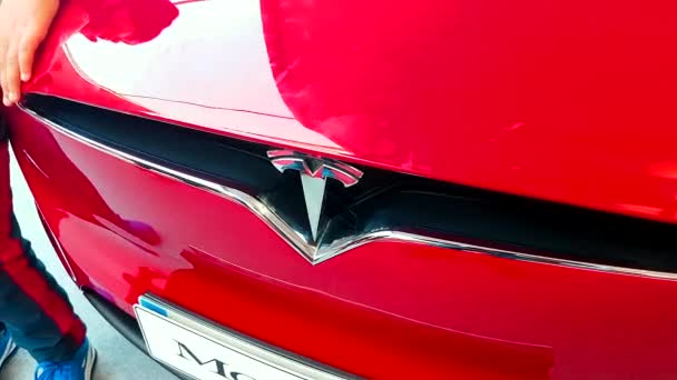 Monte-Carlo, Monaco - February 18, 2018: Tesla Motors Logotype on a Red Model X Electric Luxury SUV. Close-Up Front View - 4K Video