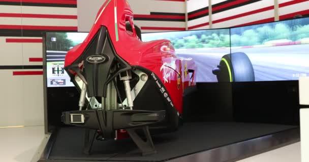 Modena, Italy - January 18, 2020: Man Driving A Realistic Ferrari Formula One Simulator Video Game, Evotek F1 Simulator In Modena, Italy, Europe. Close Up Rear View - DCi 4K Video