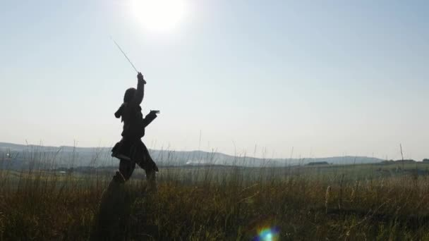 Silhouette of a Viking training using the sword for battle.