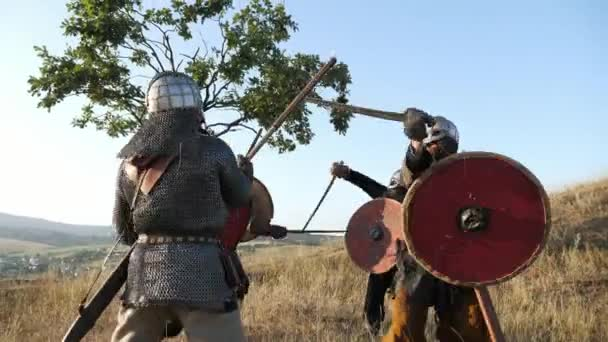 Medieval Warriors of Vikings are fighting during attack. Close-up